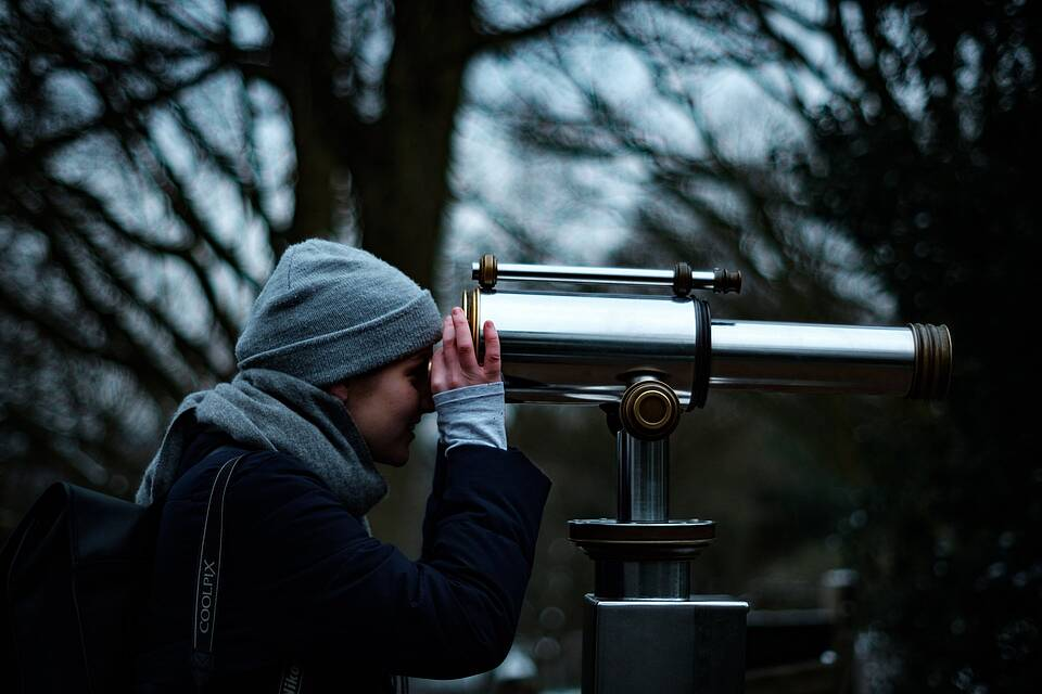 woman and a telescope